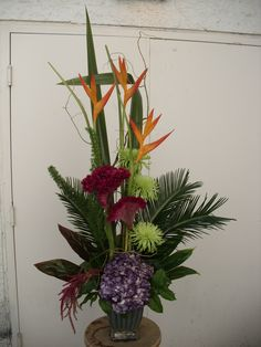 Pink, purple and orange flower arrangement for wedding and events.