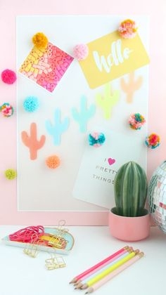 DIY Fluffy Yarn Pom Pom Magnets | lovelyindeed.com