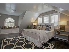 Kelly Clarkson's Bedroom...love the neutral palette, the grey rug, and the window seat. So homey.