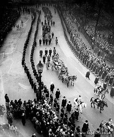 King George VI's funeral procession through London from Westminster to Paddington Station - The Queen's Carriage seen in the procession approaching the Mall. In the carriage are The Queen, The Queen Mother, Princess Margaret and the Princess Royal.  Following the carriage are the four Dukes of Kent, Windsor, Gloucester and Edinburgh - 15th February 1952