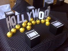 Hollywood Centrepiece in popcorn bags with styrofoam in the bottom half instead