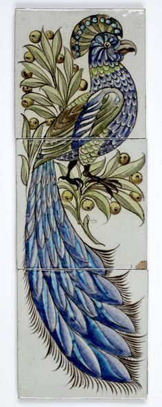 Designed by William De Morgan this panel of three stoneware tiles is decorated with a stylized image of a peacock using oxides painted onto white slip. Sands End Pottery, Fulham. © Hull Museums, Hull and East Riding Museum.
