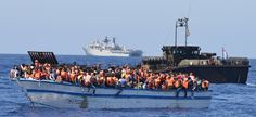 Pictured: 369 migrants crammed into a heavily overcrowded wooden hulled boat which was located in the waters just north of Libya.HMS Bulwark has conducted another migrant rescue mission in the central Mediterranean.   The Royal Navy flagship was alerted that up to 400 migrants were crammed into a crowded wooden hulled boat in waters just north of Libya earlier this afternoon.   The ship sent 5 of its landing craft to rescue the migrants, 50 of whom were small children.