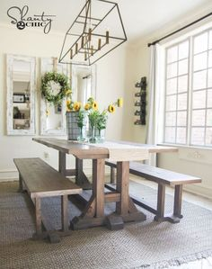 A farmhouse table with benches in a dining room