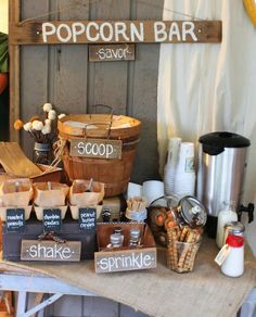 If you are looking for a fun way to entertain your guests at your reception, this popcorn bar is a great idea.