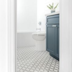 Cement Tile Shop - Circulos Grey II Pattern - This bathroom by is described as classic coastal.and we're digging it. The in stock Circulos Grey II Pattern fits right in on the floor. Photo by Cement Tiles Bathroom, Bathroom Flooring, Grey Floor Tiles, Grey Flooring, Diy Bathroom Remodel, Bathroom Ideas, Family Bathroom, Bathroom Inspiration, Beautiful Small Bathrooms