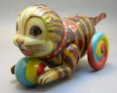 """Vintage Lithographed Tin Toy made in Japan; circa 1930 approximately 8 3/8"""" x 3 1/8"""" x 4"""" h"""