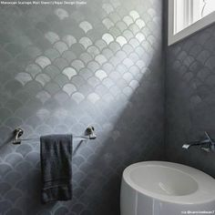 Modern gray bathroom features walls clad in gray metallic fishscale tiles lined . - Modern gray bathroom features walls clad in gray metallic fishscale tiles lined with a modern white - Trendy Bathroom, Fish Scale Tile Bathroom, Stencils Wall, Grey Bathroom Tiles, Wall Stencil Bathroom, Amazing Bathrooms, Bathroom Feature Wall, Bathroom Decor, Grey Feature Wall