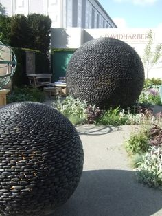 river rock garden balls - better start collecting on my walks down the gravel roads :) Garden Show, Garden Art, Garden Design, Botanical Gardens Near Me, Garden Balls, Annual Flowers, Chelsea Flower Show, Garden Inspiration, Backyard Landscaping