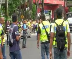 VIDEO: A pro-government Red Shirt protester being taken away by the police for attempting to assault the Bersih group on the streets.