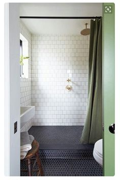 For A + M bathroom  white subway tile black penny rounds classic