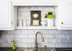 Large white subway marble kitchen backsplash tile with black countertop and white cabinets from Backsplash.com