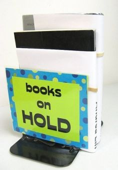 Don't know what to do with old scratched up or ugly metal book ends? Need to make free-standing small signs? Make paper signs (cap-sigs) to slip over the top of bookends and give them a new purpose!