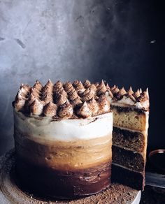 A decadent mélange of dark chocolate, espresso and vanilla layers brought together with a creamy ombré mascarpone frosting, everything you love about a classic Tiramisu in one cake! Speckled w…