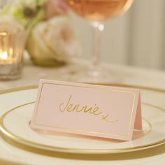 Pastel Pink And Gold Foiled Place Cards. Pastel pink place card with gold foiled edging, with room to write guests names so places can be easily found at the wedding table.