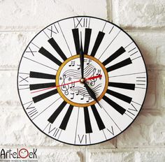 "The ""Do Re Mi""  Wall Clock, Piano Music Gifts. $29.90, via Etsy."