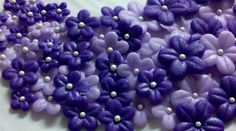 Edible Purple and Lavender Fondant Flowers-Set of 30-Cake/Cupcake Toppers-Purple Flowers-Edible Flowers by KandyKoncepts on Etsy https://www.etsy.com/ca/listing/128943069/edible-purple-and-lavender-fondant