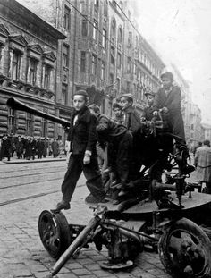 October 1956 Budapest Hungary Hungarian Uprising Children play in the street on an abandoned gun as the Communist uprising takes place Somewhere In Time, Budapest Hungary, Ny Times, Kids Playing, Revolution, Monster Trucks, Novels, Stock Photos, History
