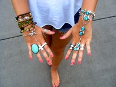 Now that is well-layered jewelry. I also love that turquoise eternity bracelet on the right.