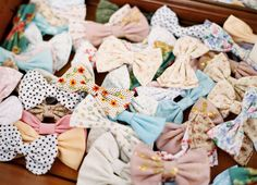 Bow full of bow ties! What a fun photo booth prop for a preppy wedding {Photo by Ryan Ray via Project Wedding}