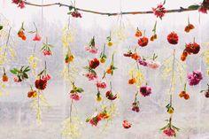 hanging flower decorations - photo by Lara Hotz http://ruffledblog.com/australian-polo-club-wedding
