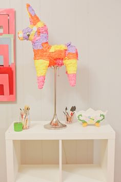 DIY Piñata Lamp To make the piñata lamp simply purchase a piñata (or make a piñata). Then cut a large enough hole in the bottom for your light bulb to fit through and place on the lamp. Turn the switch on for a pretty glowing piñata lam Diy And Crafts, Crafts For Kids, Arts And Crafts, Paper Crafts, Bright Paint Colors, How To Make Pinata, Fiesta Party, Party Party, Party Time
