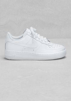 NIKE A modern take on Nike's popular AF-1, these basketball style sneakers have a modern silhouette, a thick midsole, and ample ankle cushioning.