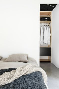 Bedroom with walk-in closet behind bed. Maja by Deko.