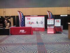 TradeShow Display internally lit.Table drape, Side pop up display. Two Amercian Flag wave banners.