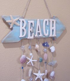 Beach Decor Sign, Coastal Decor, Beach House Decor, Beach Wall Art, Beach Wind Chime, Beach Decor Coastal, Seashell Wind Chime, Coastal Gift ------------------------------------------ Beach Shell Windchime was hand painted with a distressed finish and is loaded full of texture and color! This wood arrow sign has been hand painted and antiqued and sealed with an acrylic sealant. Wood BEACH letters are also antiqued and sealed, and have been affixed to the arrow for dimension and style! A 3-4…