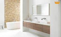 Een wastafel meubel op maat, van muur tot muur zwevend geeft een luchtig en ruim effect - www.witzand.nl