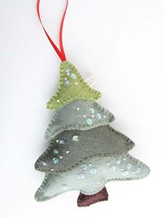 Felt Christmas Tree - Pretty by Hand - - felt tree – I can see making a bunch of these for Christmas gifts and/or package toppers. Maybe a weekend project idea to do with Mom? Felt Christmas Decorations, Felt Christmas Ornaments, Noel Christmas, Handmade Christmas, Diy Ornaments, Beaded Ornaments, Glass Ornaments, Tree Decorations, Handmade Decorations