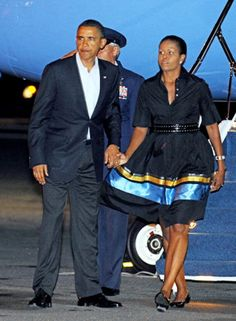 Every woman needs a trusty little black dress! Worn with chic sandals and her trademark accessory - the cardigan - Michelle prepares to fly from Boston to Washington with Barack on Aug. 30.