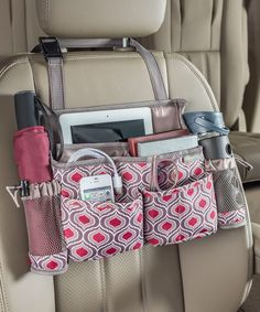 A car front seat organizer with 8 pockets for tablets, smartphones, water bottles, sanitizer and more. Grab the handle and swing it to become a back seat organizer for passenger access. High Road has the best selection of car organizers available. Car Seat Organizer, Car Organizers, Sew Organizer, Car Office, Car Essentials, Car Storage, Car Hacks, Cute Cars, Diy Car