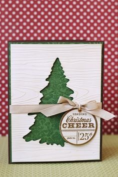 Christmas card ... white woodgrain embossed with negative die space tree showing subtle green print paper below ... bright & clean look ...