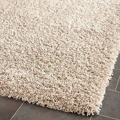 This power-loomed cozy shag rug offers luxurious comfort and easy design styling. High-density polypropylene pile features a beige and ivory mix background and provides one of the most plush feels available in a rug.