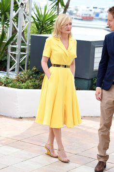 Kirsten Dunst wore a bright yellow Dior dress with a full skirt to a photocall for the 2016 Cannes jury.