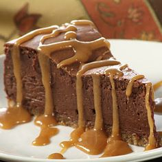 French Chocolate Cheesecake - Served with caramel sauce this delicious French Chocolate Cheesecake is sure to please all the chocolate lovers in your family!