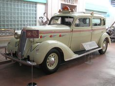 """The Museum's plackard for this car reads:  1936 DESOTO Model:  DeLuxe Airstream Taxlcab Built By:  Chrysler Corporation DeSoto Division Detroit, Michigan Body By:  Brlggs Price:  $ 1,075 Engine:  L-Head 6 Cylinder, 93 H.P. Bore:  3-3/8"""" Stroke:  4-1/2"""" Displacement:  241.5 cu. in.  The DeSoto was launched by Chrysler Motors Corporation in 1928 as a 6-cylinder car to compete with Oldsmobile, Pontiac and Nash.  The new line sold well, with over 90,000 DeSotos produced in the first twelve…"""