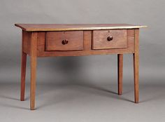 A Good American Federal Cherrywood Huntboard, early 19th c., probably Southern, the thick single board top above a pair of large molded edge drawers, with Bennington-style pottery knobs, raised on square tapering legs, height 34 in., width 54 in., depth 22 in.