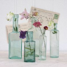 Set Of Four Vintage Glass Bottles Magpie Living