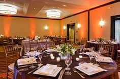 Dark tablecloths and colored lighting create a chic wedding reception at Crystal City Marriott at Reagan National Airport. {Crystal City Marriott at Reagan National Airport}