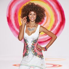 Desigual women's Clyde T-shirt, with rhinestone and sequin embellishments on the print. It has hand-stitched details around the bottom.