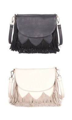 Pebbled textured crossbody bag with genuine soft suede fringes, snap front closure and back zipper pocket.