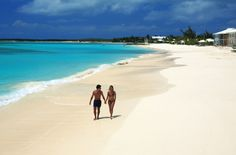 Couple walking hand in hand at the Cape Santa Maria Beach Resort