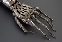 Steel and brass arm prosthesis is a good example of devices used between 1840 and 1940.