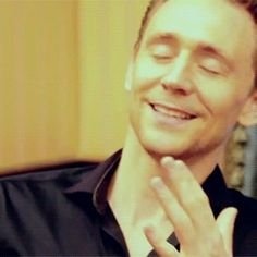 Tom Hiddleston has the sexiest and sweetest smile ever