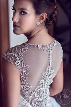 Totally love the illusion neckline and back on the CB Couture gown as seen on BRIDE.Canada