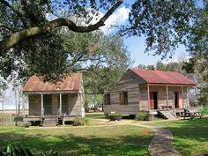 Old Public School & Slave Cabin--San Francisco Plantation, River Road, Louisiana.