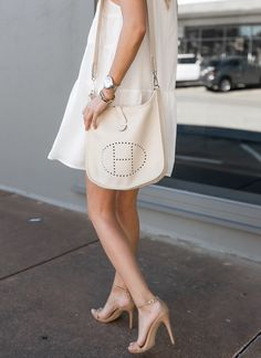 The best part about warmer temps is being able to throw on a little white sundress and head right out the door for dinner. Best Handbags, Hermes Handbags, Hermes Evelyn Bag, Hermes Clutch, White Sundress, Hermes Paris, French Girls, Lady Dior, Cloth Bags